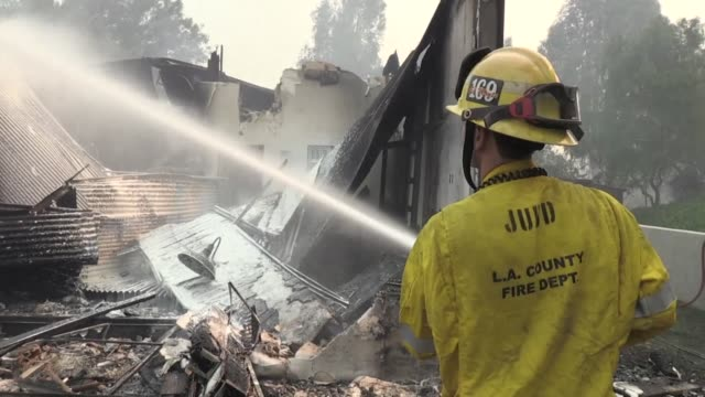 the malibu hills home to hollywood stars are unrecognizable after a wildfire raged through the area firefighters are trying to put out fires and stop... - malibu stock videos & royalty-free footage