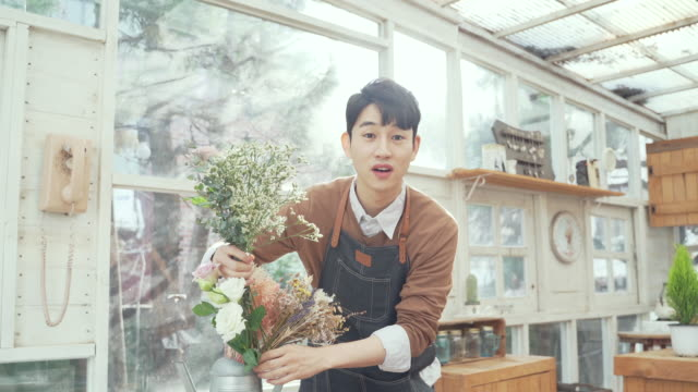 The man doing flower arrangement in the home