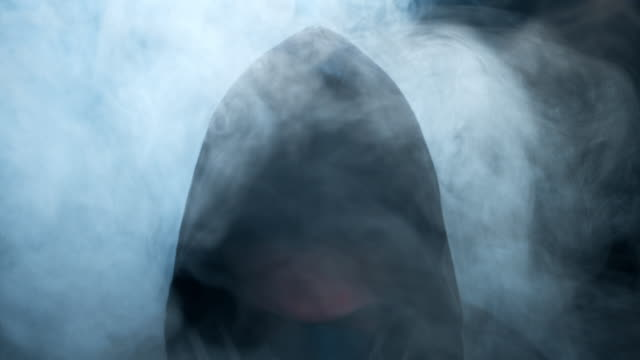 the man in the gas mask raises his head and the smoke gradually clears - gas mask stock videos & royalty-free footage