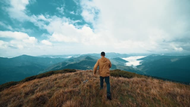 The man running on the picturesque mountain