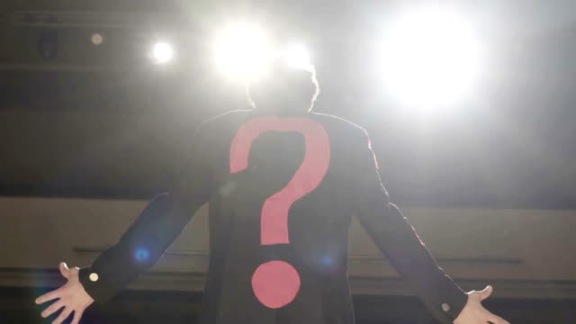The man with question mark jacket on the theater