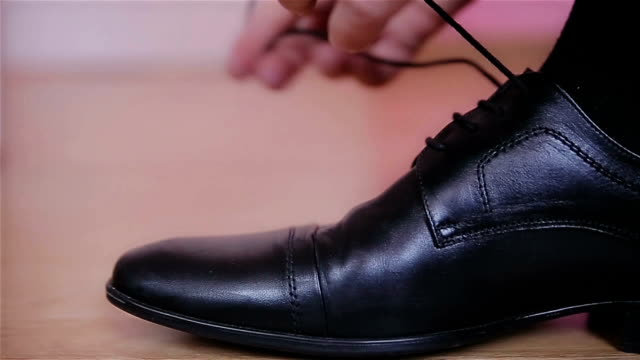 the manager is wearing shoes,close up - shoelace stock videos and b-roll footage