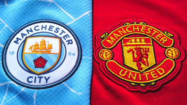 the manchester united and manchester city home shirts displaying the club badges on june 08, 2021 in manchester, united kingdom. - shirt stock videos & royalty-free footage