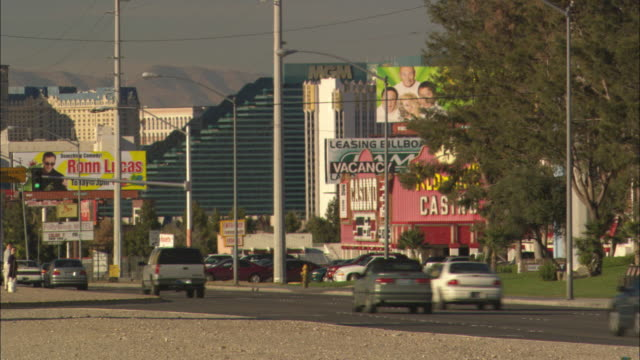 The Mandalay Bay electronic sign flashes near the iconic 'Welcome to Fabulous Las Vegas' sign on The Strip.