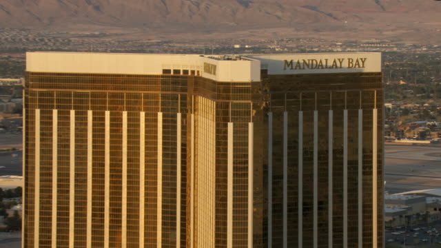 the mandalay bay hotel and casino provides an example of extravagant architecture in las vegas. - mandalay bay resort and casino stock videos & royalty-free footage