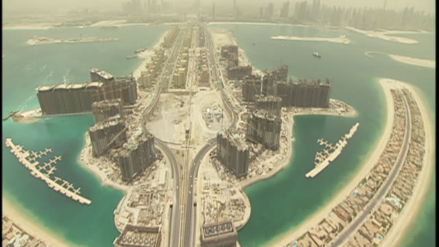 The man-made archipelagos of Palm Jumeirah and the Palm Islands are seen from the air.