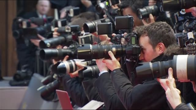 The many photographers working the BAFTAs 2014