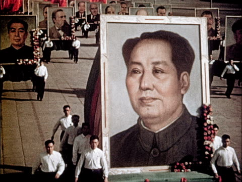 the march of 'the half a million' / marching with chinese flags / carrying large portraits of mao tse-tung and sun yat-sen and other communist... - mao tse tung video stock e b–roll