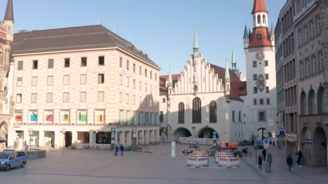 the marienplatz beeing nearly empty following the tightening of measures affecting public life due to the coronavirus all non essential shops have... - lockdown stock-videos und b-roll-filmmaterial