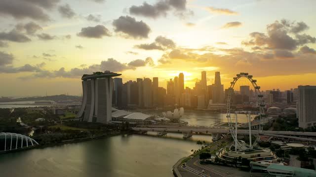 the marina bay sands in singapore city skyline. sunrise - film composite stock videos & royalty-free footage