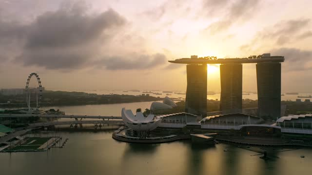 the marina bay sands in singapore city skyline. sunrise - digital composite stock videos & royalty-free footage