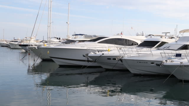 The marina of Puerto Banus of Marbella in Andalusia in Spain with a lot of expensive boats reflecting in the sun
