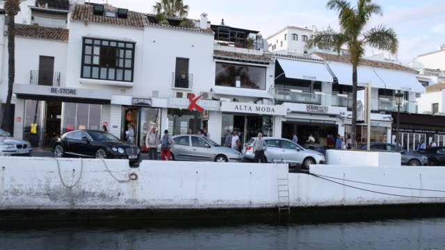 The marina of Puerto Banus of Marbella in Andalusia in Spain with a lot of expensive boats and expensive shops and the famous Sinatra bar can be seen...