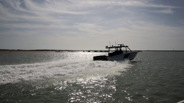 The marine unit patrols coastline waters near the USMexico border searching for drug smugglers as well as illegal immigrants which come across from...