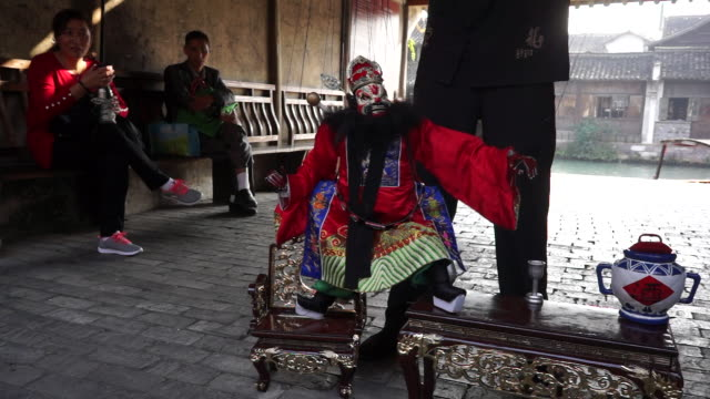 the marionette show originated in quanzhou and has the longest continuous history among all kinds of ancient chinese puppetry - marionette stock-videos und b-roll-filmmaterial