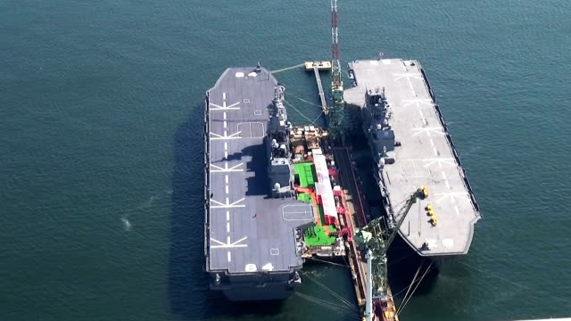 the maritime selfdefense force's kaga helicopter carrier its jointlargest warship was commissioned here on march 22 japan the ceremony to deliver the... - japan self defense forces stock videos and b-roll footage