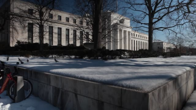 The Marriner S Eccles Federal Reserve building stands surrounded in snow in Washington DC US on Friday Feb 14 Wide shot of the Federal reserve...