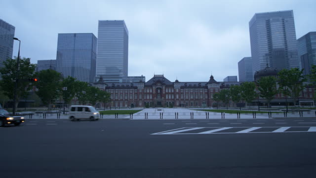 the marunouchi exit of the tokyo station in a cloudy morning - garbage truck stock videos and b-roll footage