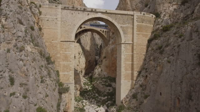 the mascarat bridges, the mascarat canyon or the (salat ravine). it divides the sierra de bernia from the sierra de toix. located on the border between calpe and altea, alicante province,costa blanca,spain - ancient stock videos & royalty-free footage