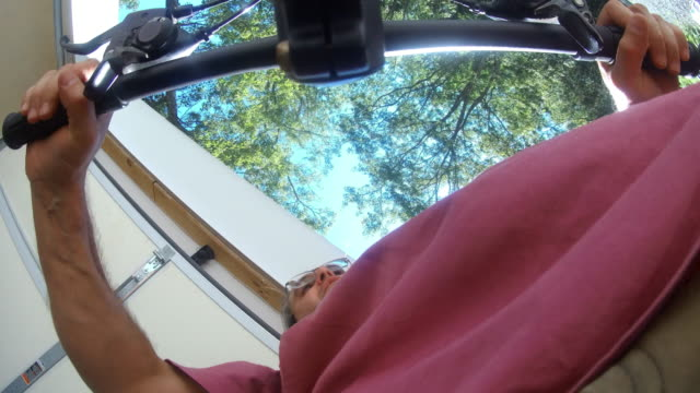 the mature 45-years-old man leaving a garage and riding a bike on the road in the community - 45 49 anni video stock e b–roll
