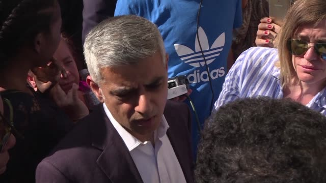 The mayor of London Sadiq Khan is greeted by a mob of angry locals demanding answers from authorities over a fire in a tower block in which 17 people...