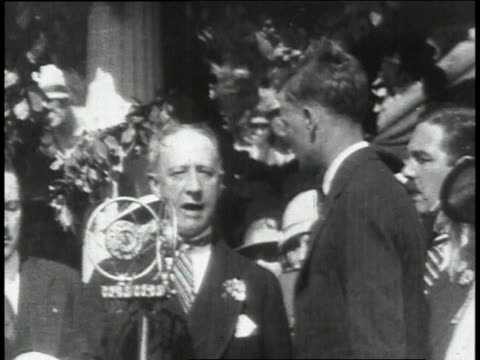 the mayor presents lindbergh with medal of valor and a close up of the american flag / new york new york united states - 1927 bildbanksvideor och videomaterial från bakom kulisserna