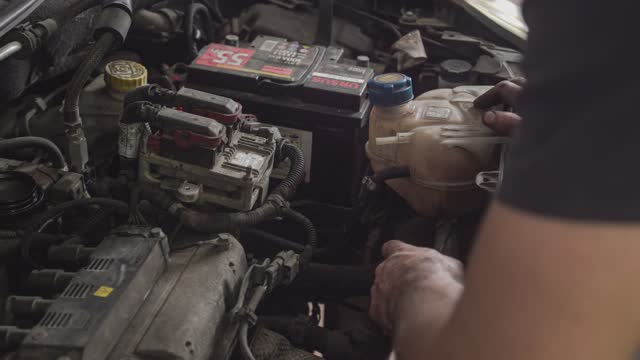 the mechanic puts his hands in the engine in milan, italy on august 5, 2021. - hipster culture stock videos & royalty-free footage