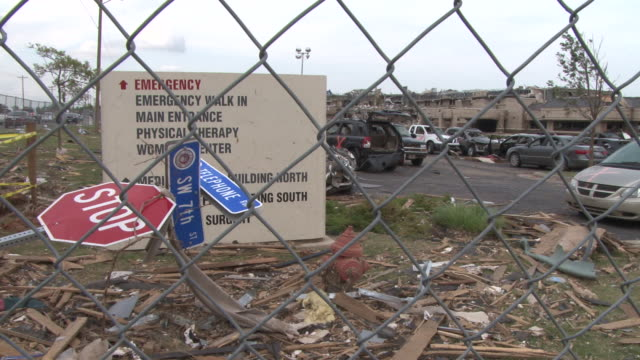 the medical center in moore ok is completely destroyed along with vehicles in the parking lot by the devastating ef5 tornado on may 20th 2013 - 2013 stock videos & royalty-free footage