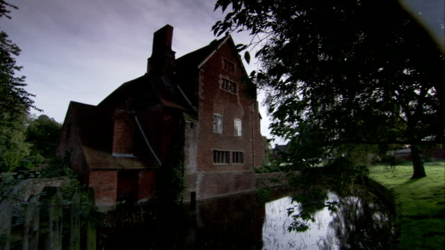 The medieval Harvington Hall surrounded by a moat. Available in HD.