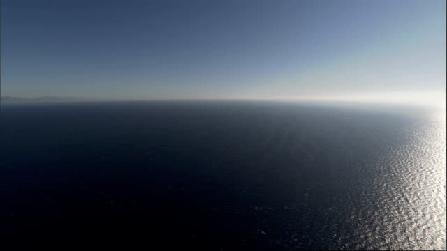 the mediterranean sea stretches to the horizon. available in hd. - vattenlandskap bildbanksvideor och videomaterial från bakom kulisserna