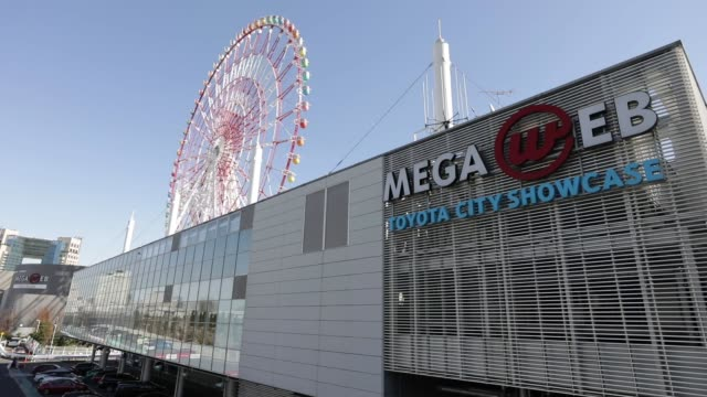 the megaweb car theme park, which houses toyota motor corp.'s showroom in tokyo, japan, on friday, feb. 3, 2017. shots: signage for toyota motor... - alpha cell stock videos & royalty-free footage