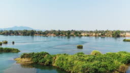 The Mekong River and a few islands with a view of the riverbank, in Don Det, 4000 islands, Laos on a summer day.