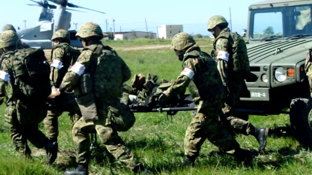 the members of us marine corps members and japanese ground selfdefense force held more rounds of joint exercises to retake an island that was... - japan self defense forces stock videos and b-roll footage