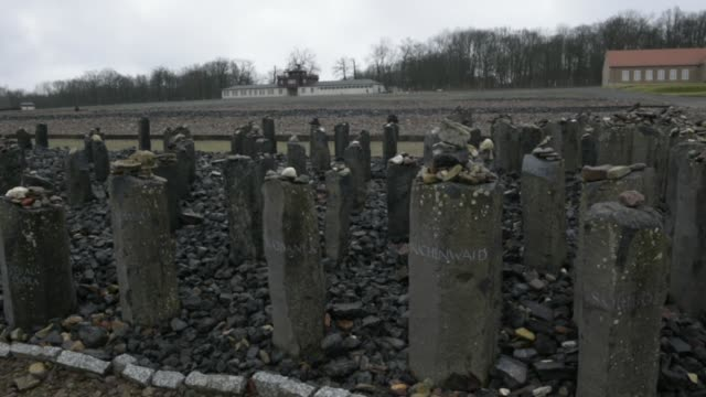 the memorial for the killed sinti and roma is displayed at the buchenwald concentration camp on january 26, 2018 near weimar, germany. tomorrow,... - weimar video stock e b–roll