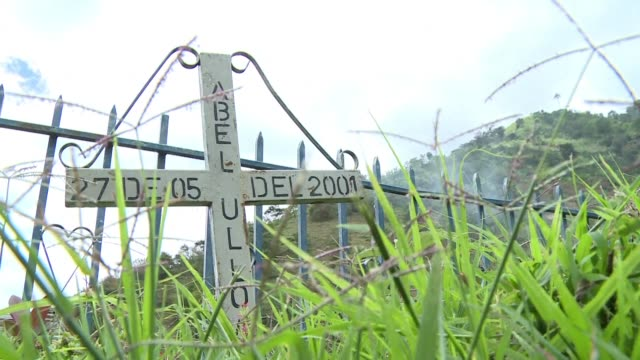 the memory of a girl who died when her house exploded is etched in the collective memory of san miguel a town in colombia strongly influenced by the... - militant groups stock videos & royalty-free footage
