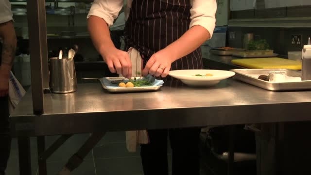 the menu for the bafta television awards includes english asparagus with truffle emulsion, glazed feather blade of beef and a sumptuous pudding... - bafta mask stock videos & royalty-free footage
