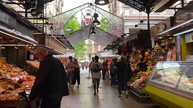the mercat de sant josep de la boqueria, spanish:  large public market in the ciutat vella district of barcelona, catalonia, spain, and one of the city's foremost tourist - barcelona spain stock videos & royalty-free footage