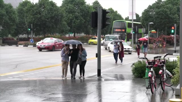 the mercury dipped to around 22 degrees celsius in singapore - monsoon stock videos & royalty-free footage