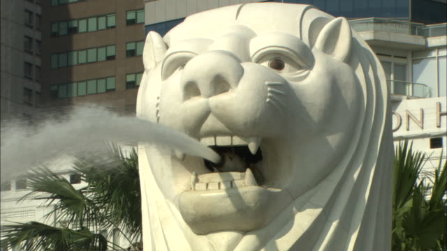the merlion and buildings: zoom back. - merlion fictional character stock videos and b-roll footage