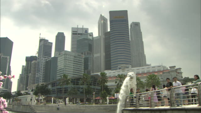 the merlion and the buildings: dolly. - merlion fictional character stock videos and b-roll footage