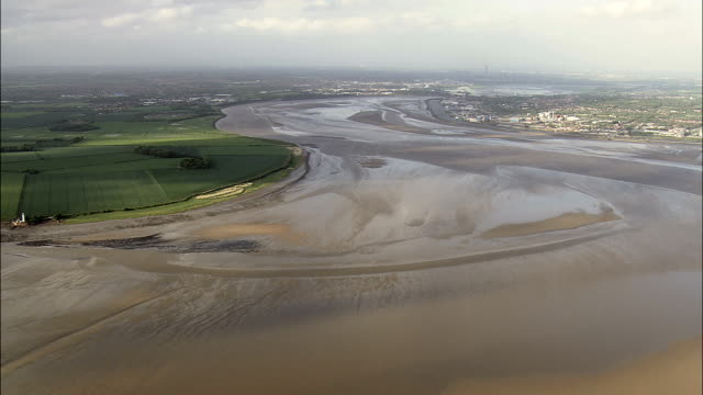 the mersey  - aerial view - england,  liverpool,  helicopter filming,  aerial video,  cineflex,  establishing shot,  united kingdom - mud flat stock videos and b-roll footage