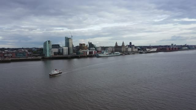 the mersey ferry passes the waterfront on october 14, 2020 in liverpool, england. the liverpool city region was placed into the highest tier of the... - mersey ferry stock videos & royalty-free footage