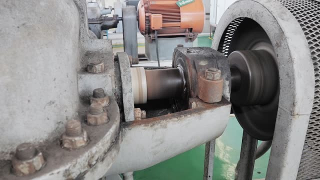the metal steel drive shaft of a water pump - lubrication stock videos & royalty-free footage