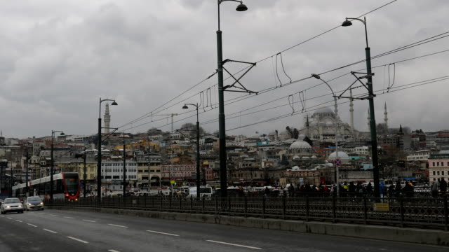 The metro train is seen passing across the Galata bridge on February 16 2016 in Istanbul Turkey