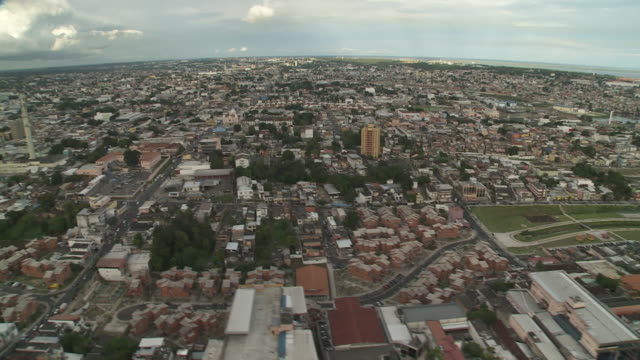 the metropolis of manaus, brazil appears to stretch to the horizon. - manaus stock videos and b-roll footage