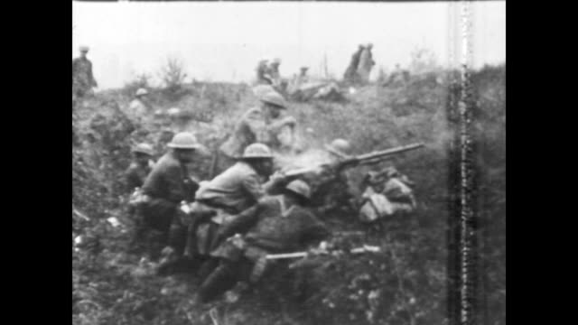 the meuse argonne offensive / trucks horse drawn carts and troops move along a road / troops wait in trenches / machine guns and artillery pieces are... - kampfpanzer stock-videos und b-roll-filmmaterial