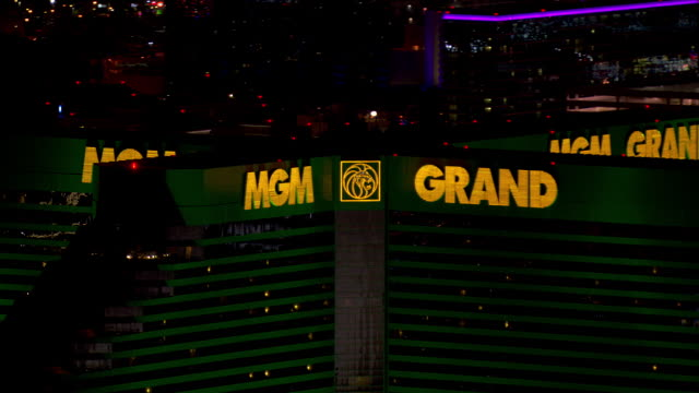 the mgm grand hotel and casino lights up the las vegas, nevada night sky. - mgm grand las vegas stock videos & royalty-free footage