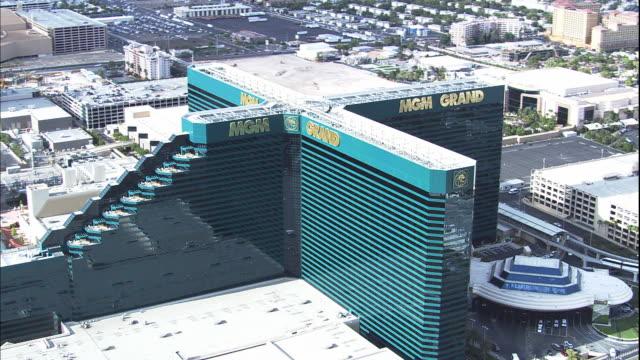 the mgm grand hotel & casino resort building on the las vegas strip. nv - tourist resort stock videos & royalty-free footage