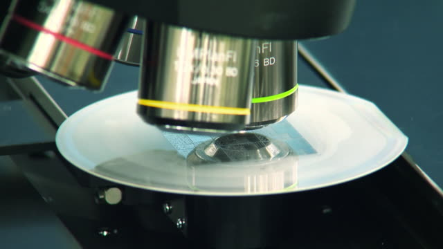 the microscopes lens and semiconductors chips - microscope stock videos & royalty-free footage