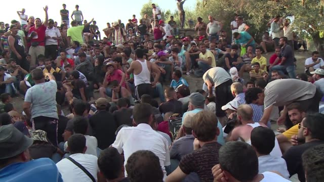 The migrant crisis on Greek island of Lesbos could turn violent with a massive backlog of refugees and frustrations running high an aid agency warns...